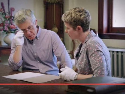 "Television personality Tom Bergeron and CSU history professor Dr. Ann Little look over documents exploring Bergeron's lineage in an episode of the TLC show, ""Who Do You Think You Are?"" (photo courtesy of the Coloradoan)"