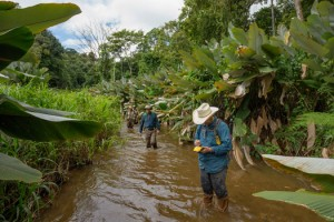 Chris Fisher consults his GPS while in the Honduran jungle.