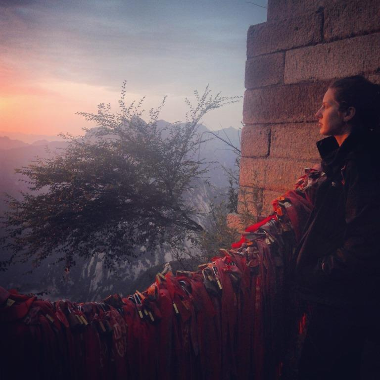 Kristen Mullen watches the sunrise from the top of Hua Shan