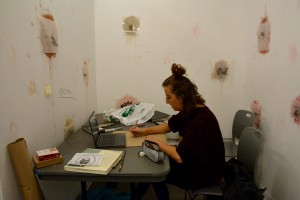 Art student Holly Nordeck works on her roadkill-inspired drawings during the 17-hour art marathon.