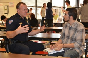 Fort Morgan Police Chief Darin Sagel, left, discusses the community relations work with CSU ethnic studies student Luis Rodriguez.