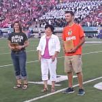 Elizabeth Sink receives an award.