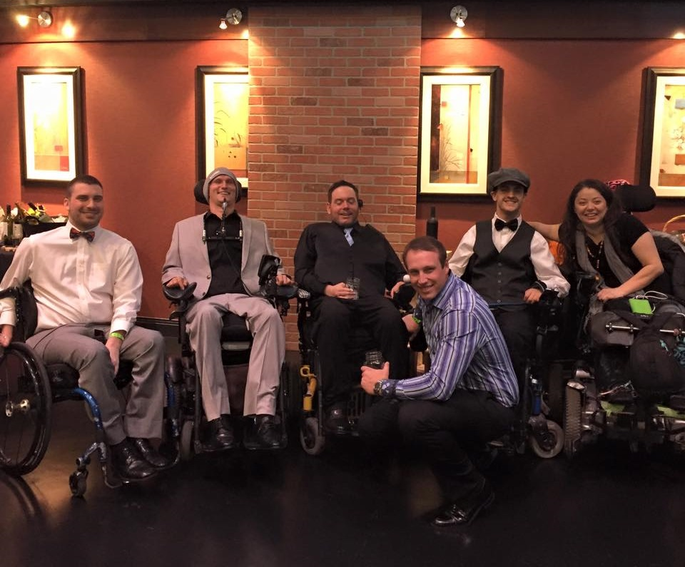 Morris with friends and colleagues at the Spinal Cord Injury Recovery Project fundraiser.