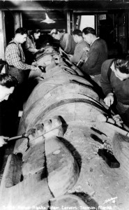 This U.S. Forest Service historical photograph shows CCC carvers restoring a totem pole at Saxman in 1939.