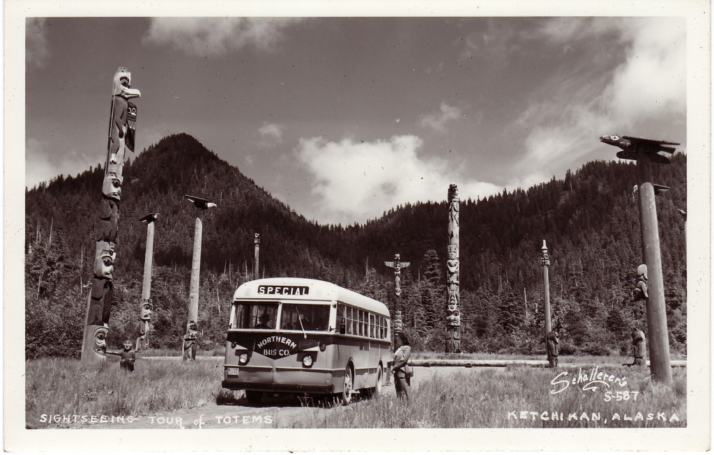 An Otto Schallerer postcard of a tourist bus arriving at the Saxman Totem Park.