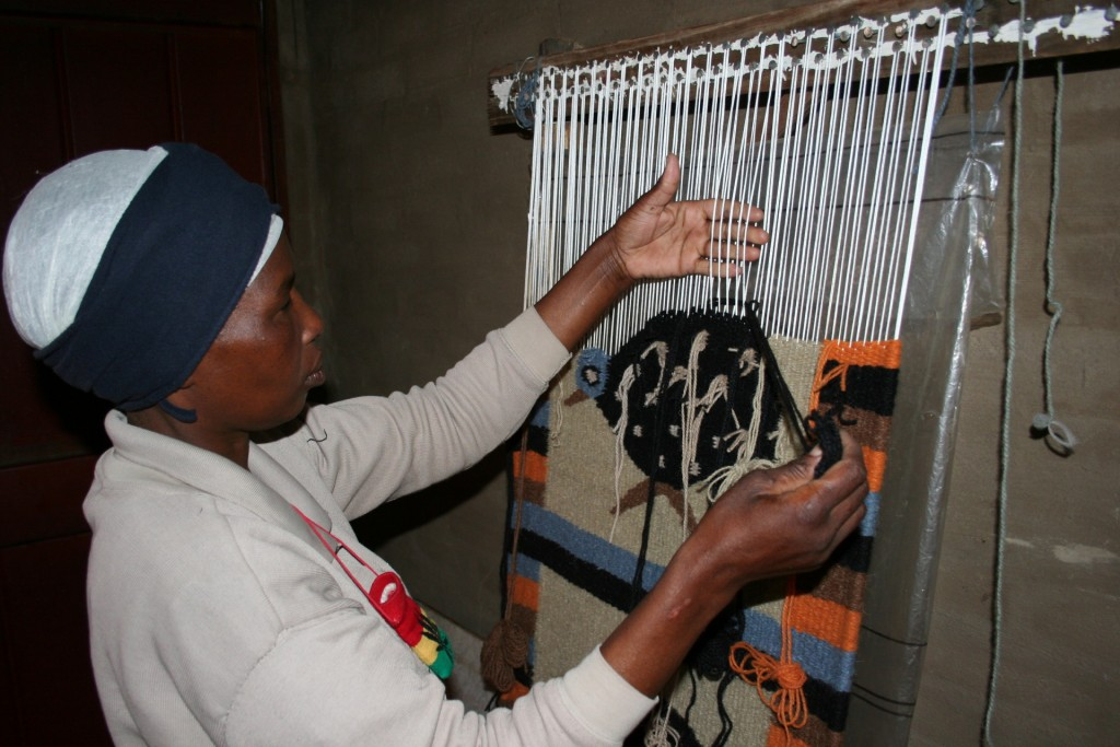 A South Sotho woman completes a weaving project.