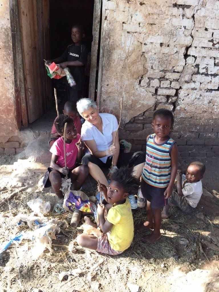 Professor Ellen Brinks with Linda Farm Community children making ecobricks for the Colorado State University compost project. Zambia, Summer 2015