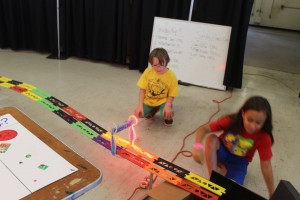 A Nerdy Derby participant anxiously waits at the finish line during his derby car race.