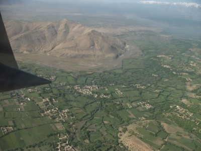 Aerial view of Afghanistan from a the paratroop door of a C-130. Photo credit of Rachael Martel.