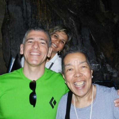 Dr. Ernesto Sagás with Caruca and the official Cuban tour guide, Idalmy, touring a cave.