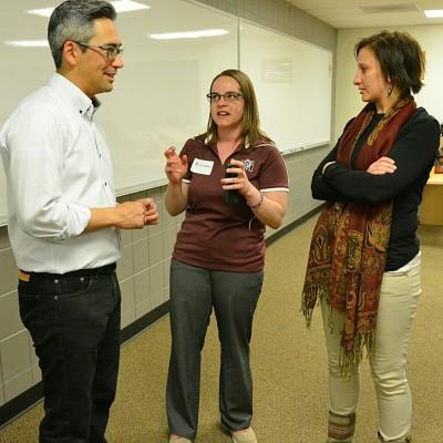 Ishiwata, left, speaks with Fort Morgan High School teachers Denise Gondrez and Taylor Jordan.