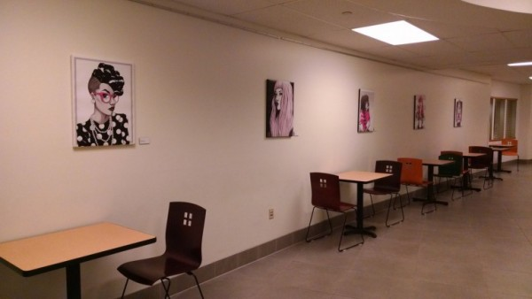 Moriah Hummer's digital paintings line the walls in the Hallery.