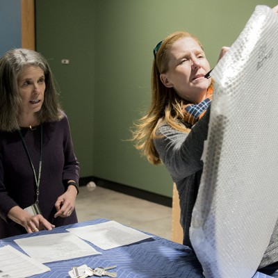 Museum Director Linny Frickman and and Collections Manager Suzanne Hale check off inventory as works arrive.
