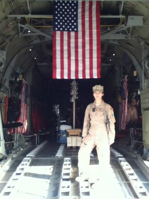 Rachael Martel standing on the ramp of a C-130 in Afghanistan. Photo credit of Rachael Martel.