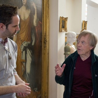 The collector, Torleif Tandstad, speaks with University Center for the Arts Creative Director Mike Solo, in his home as works of art are packed for museum delivery.