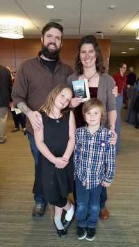 Sink poses with her family after receiving the Ann Gill Excellence in Teaching Award