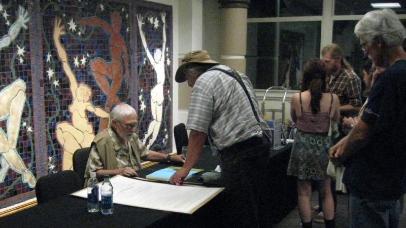 Gary Snyder signing books