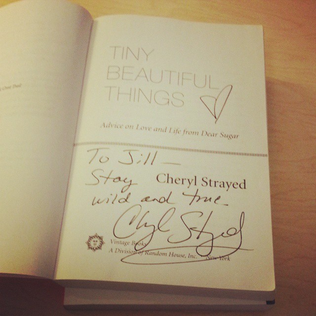 English department Communications Coordinator Jill Salahub's signed copy of Tiny Beautiful Things by Cheryl Strayed, who read as part of the CWRS in April 2015