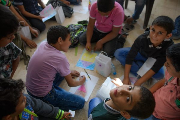 A child looks up during the coloring party in Jerash refugee