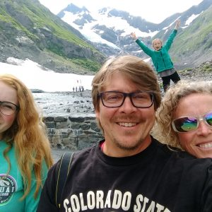 Paul DeMaret on vacation in the mountains with his wife and two daughters