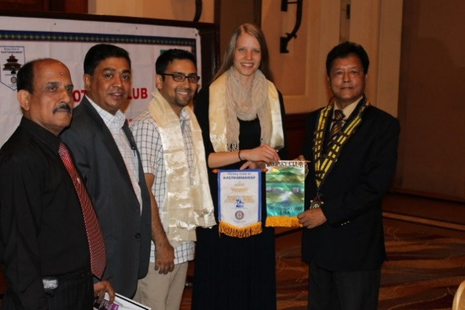 Niroj Bhattarai, third from left, and Emily Thomas, second from right, at a flag exchange at the Rotary club meeting in Nepal.