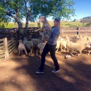 Raeann Magil holding a goat