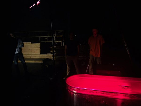 Lighting designers test how to make clear water look like blood for the performance of Big Love