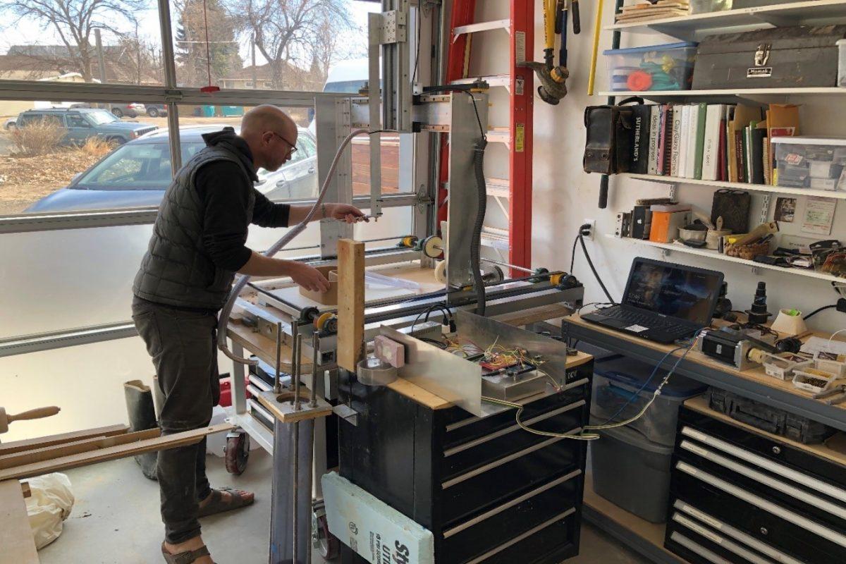 Del Harrow working in his home studio