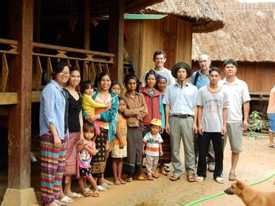 Eric Rounds with the other researchers and local people from a village in Vietnam.