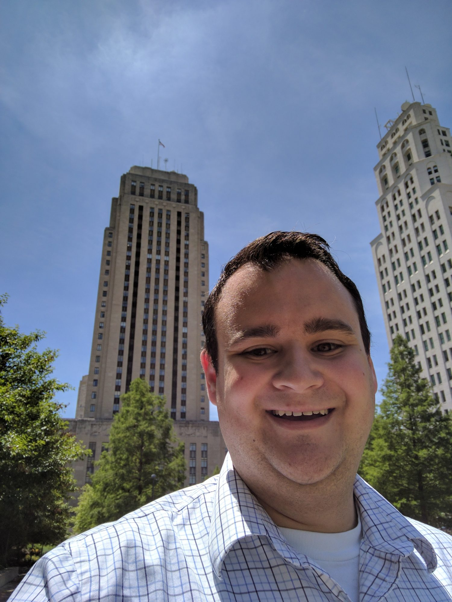 Eric Roche smiling with downtown Kansas City behind him