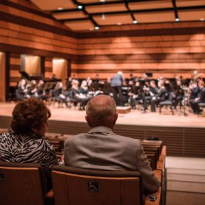 A couple sits in Griffin Concert Hall in the UCA