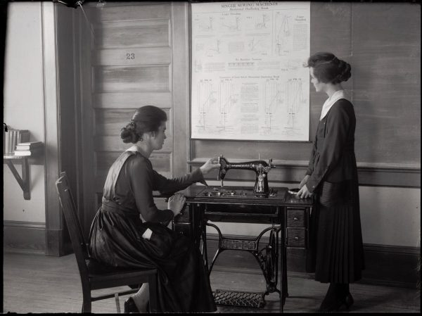1894- Domestic Economy course -Two students learning to use a Singer Sewing Machine