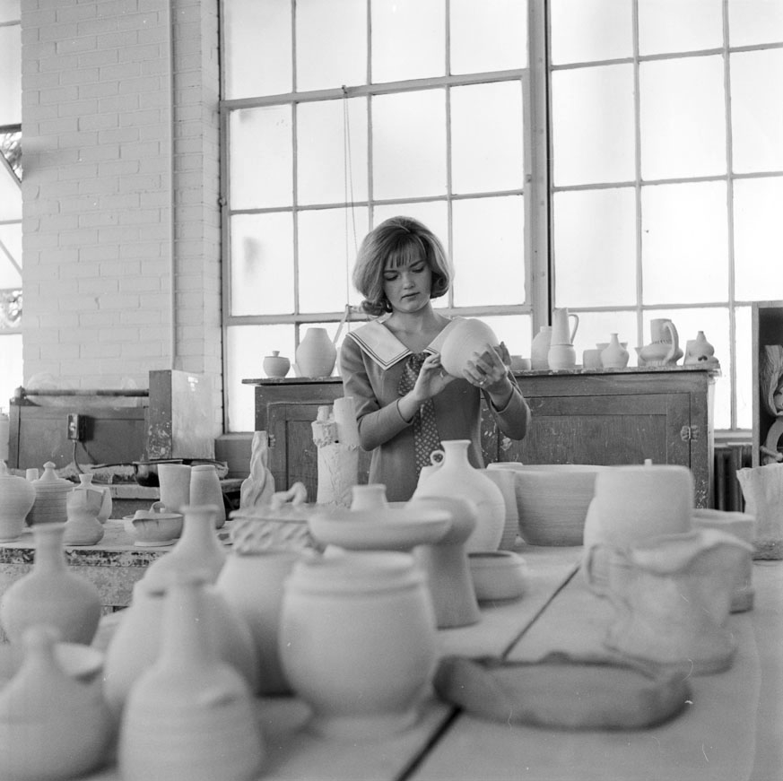 Female student in pottery class, 1965, CSU