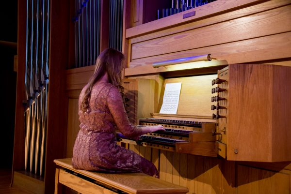 Student playing the Casavant Pipe Organ