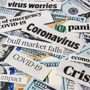 covid-19 news headlines on United States of America 100 dollar bills