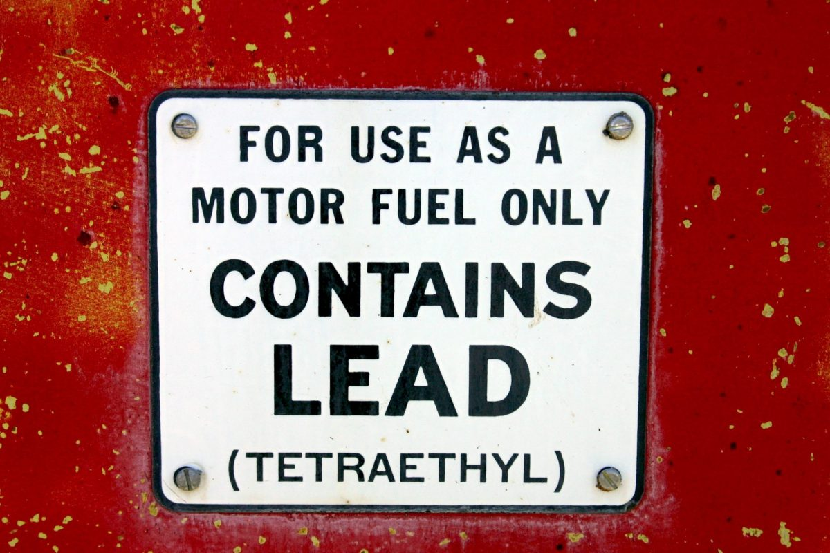 1970's sign on red /yellow gas pump showing it is leaded gas