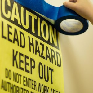 Warning sign posted for lead based paint work