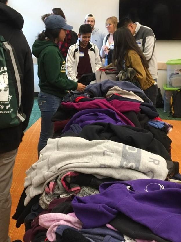 Students running a coat drive