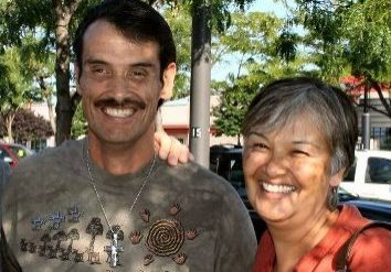 Susan Harness smiles next to her younger brother James Allen after reuniting