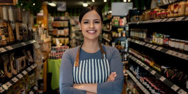 Woman standing proudly in front of her store